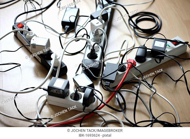 Multiple power strips for connection of multiple electrical devices, tangle of cables, connectors and power supply units