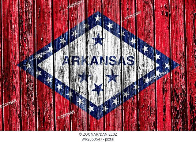 flag of Arkansas painted on wooden frame