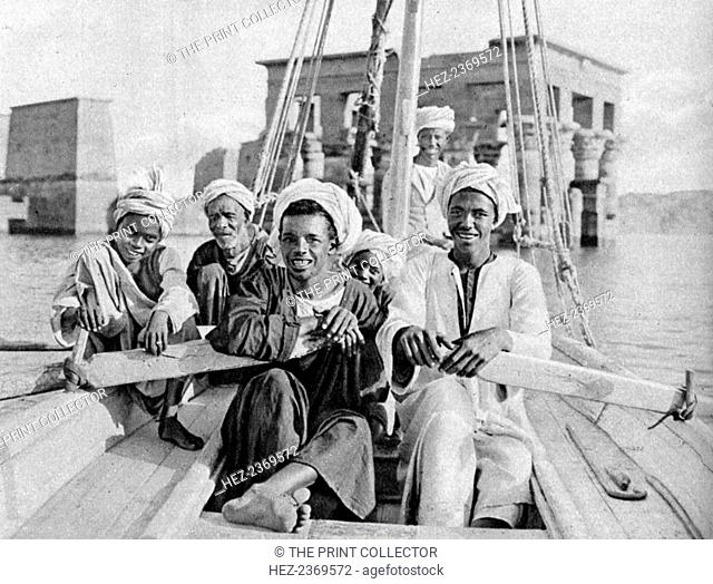 Berberin boatmen, flooded isle of Philae, Egypt, c1922. The island and its ruins were regularly flooded after the construction of the Aswan Low Dam in 1902