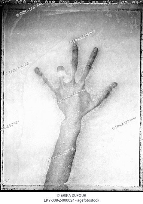 Abstract, decaying four-fingered hand'