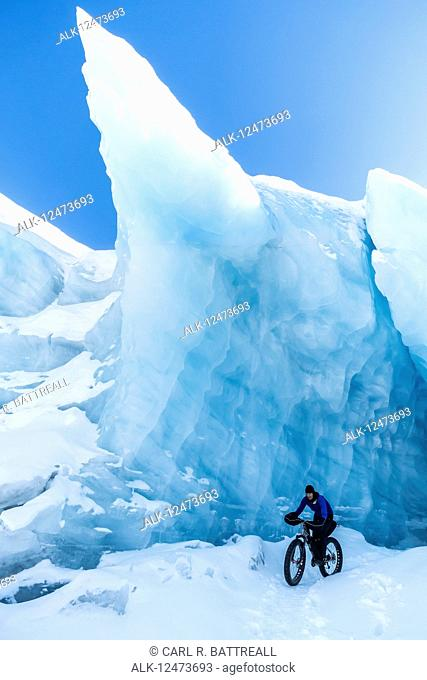Woman mountain biking with a fat tire bike at Spencer Glacier, Chugach National Forest, South-central Alaska; Alaska, United States of America