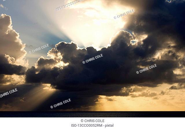 Sun breaks behind a cloud,Antigua