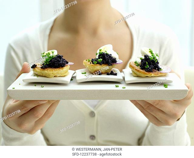 Caviar blinis with yoghurt and chives