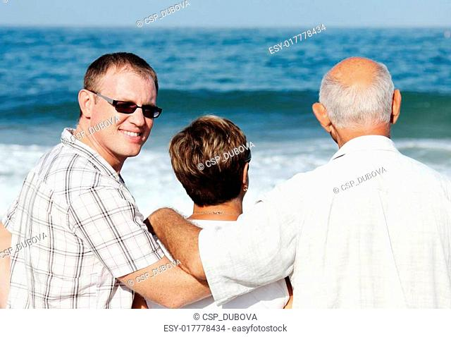 son with his parents on the beach