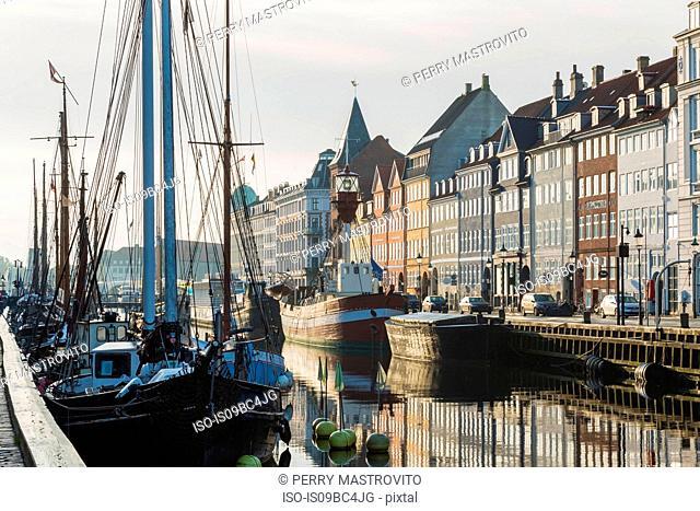 Moored sailboats and 17th century town houses on Nyhavn canal, Copenhagen, Denmark