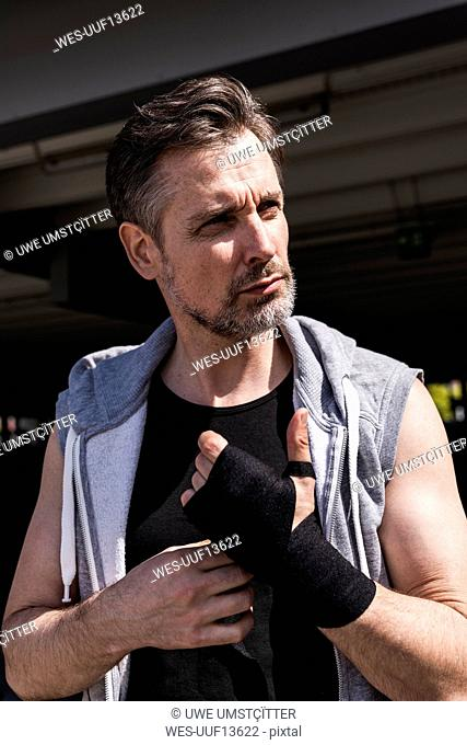 Man bandaging hands for boxing training
