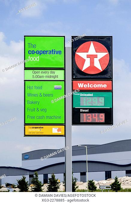 Co-operative shop sign and Texaco petrol station showing fuel prices, Wiltshire, England, UK