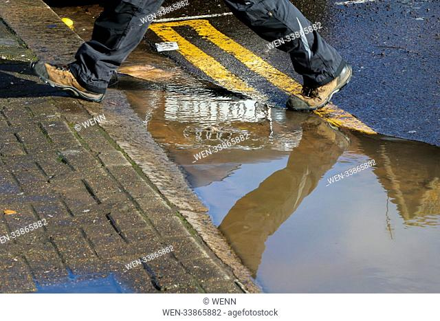 A large pothole on Dongala Road in Tottenham, north London caused by a water pipe burst. Water has been leaking through since Friday 2 March 2018 as...