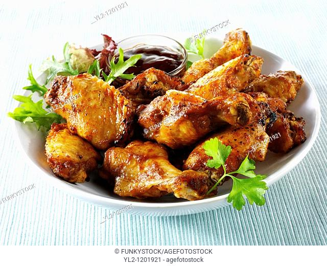 Bowl of spicy BBQ Chicken wings and thights