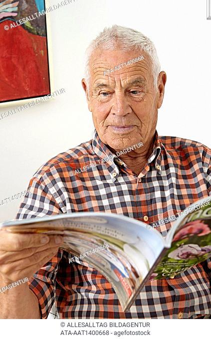 Senior reading a magazine