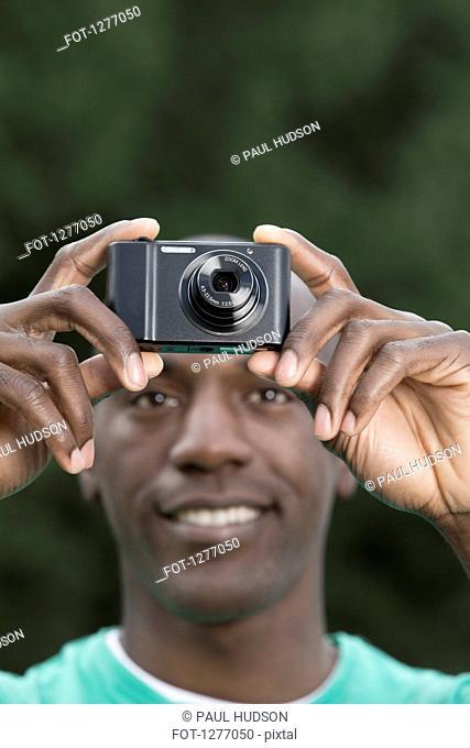 Man using digital camera