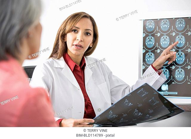 Doctor showing x-rays to patient in office