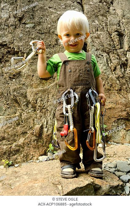 A toddler ready for some rock climbing in Strathcona Park, Vancouver Island, British Columbia