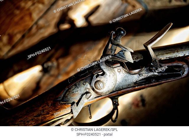 Still life of a flintlock rifle from 1824