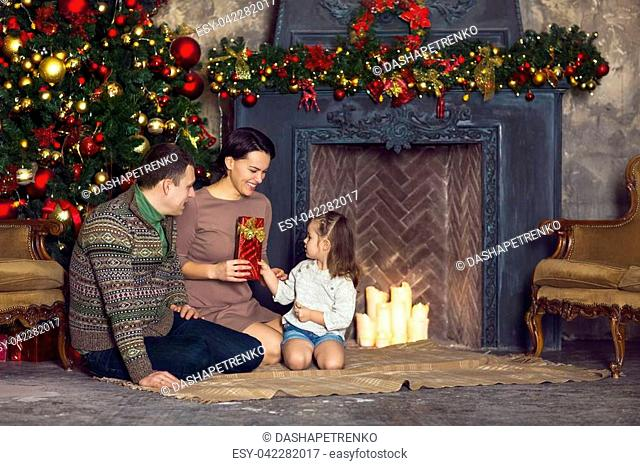Christmas family portrait In home holiday living room with decorated Christmas tree