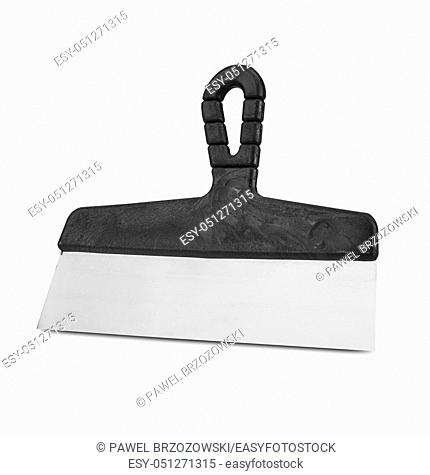 Finishing spatula on white background. Handle coating knife on white background. Stainless steel spatula with plastic handle