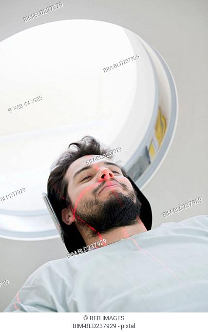 Lines on face of Hispanic patient in scanner