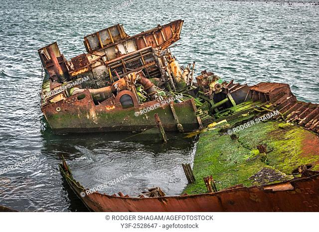 A boat run aground and stripped of all recoverable fixtures and fittings. Gaansbaai Goose Bay, Western Cape Province, South Africa.
