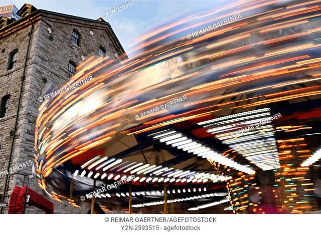 Blurred lights of spinning carousel at Toronto Christmas Market Distillery District