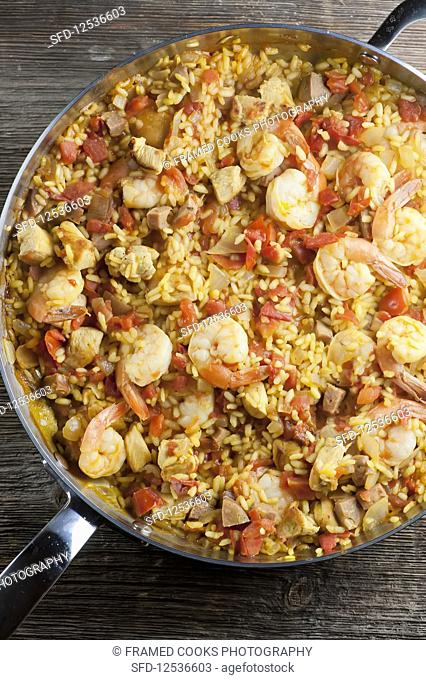 Paella with shrimps in a pan (top view)