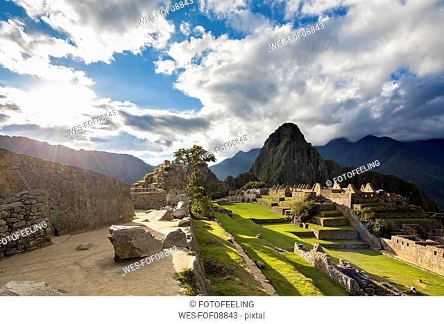 Peru, Andes, Urubamba Valley, Machu Picchu with mountain Huayna Picchu at sunset