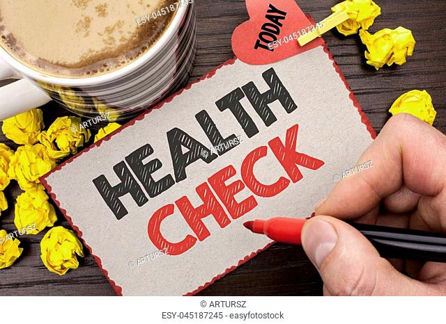 Writing note showing Health Check. Business photo showcasing Medical Examination Diagnosis Tests to prevent diseases written Man Holding Marker Cardboard wooden...