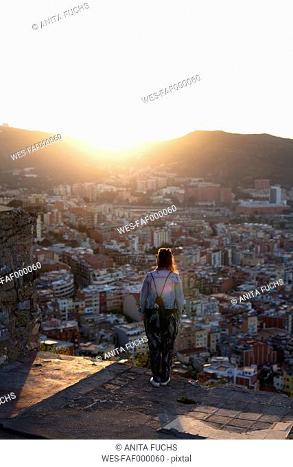 Spain, Barcelona, woman looking at view from Bunker del Carmel