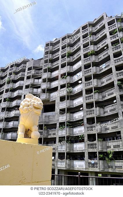 Naha, Okinawa, Japan: a Shisa on a grave of a cemetery by a huge condo in Aja, Shisa is a traditional Ryukyuan decoration, often in pairs
