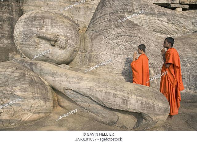 Monks praying to the Buddha, Gal Vihara, Polonnaruwa, Sri Lanka