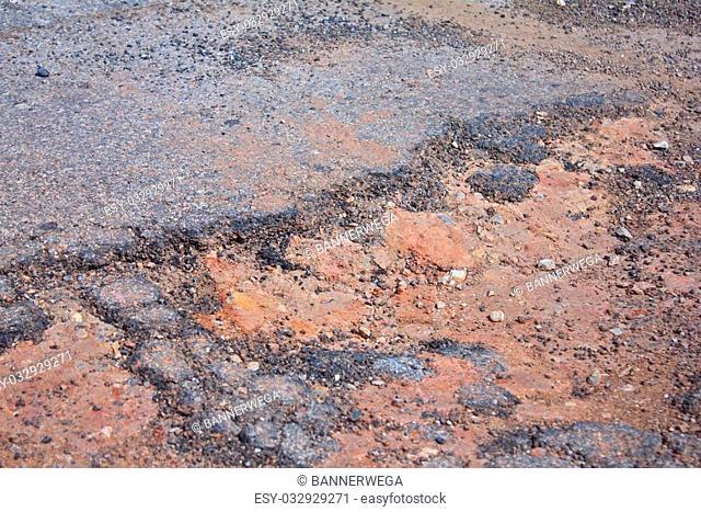 Old cracked asphalt closeup background. damage of road