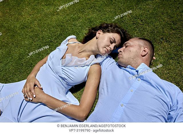 Couple lying on meadow