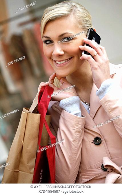 portrait of woman take a call on a cell phone in the city