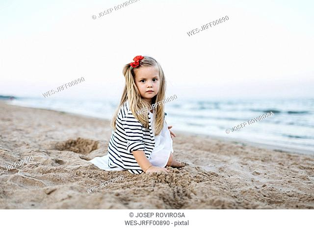 Portrait of little girl playing on the beach