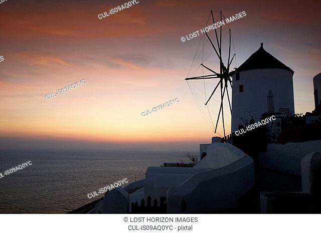 Silhouetted view of windmill and sea, Oia, Santorini, Cyclades, Greece