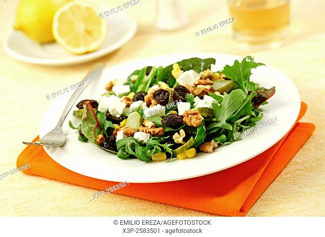Mixed salad with cheese and walnuts
