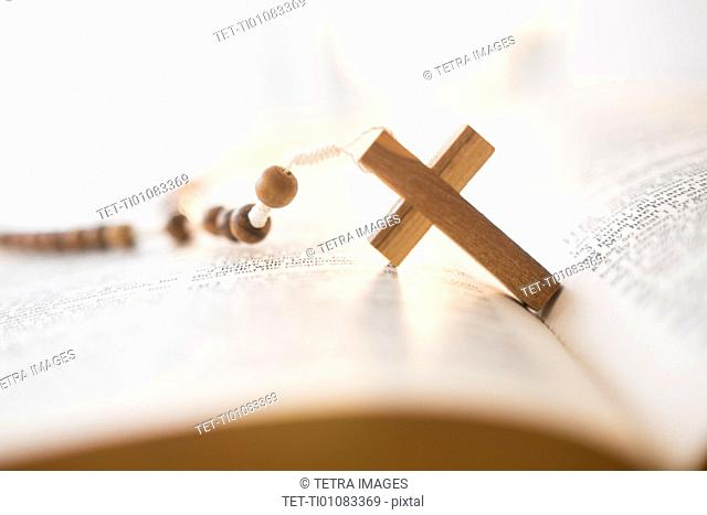 Rosary beads in open Bible
