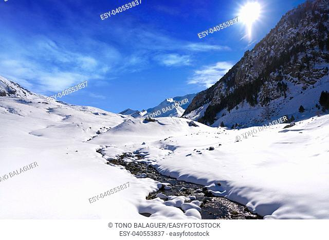 Cerler snow stream in Pyrenees of Huesca in Spain