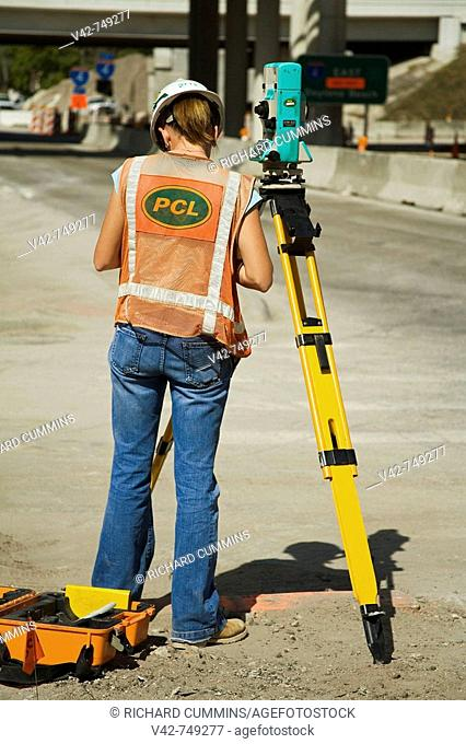 Female Surveyor working on Freeway  4 connector, Downtown Orlando, Florida, USA