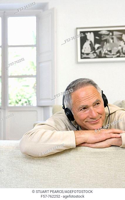 Seniar man listening music