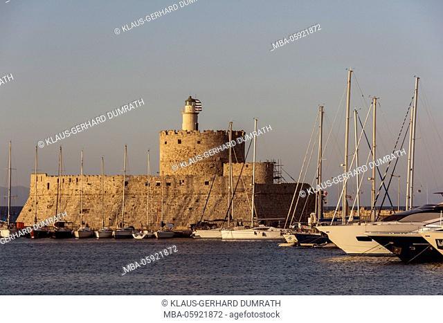 Rhodes, Mandraki harbour with fortress Agios Nikolaos