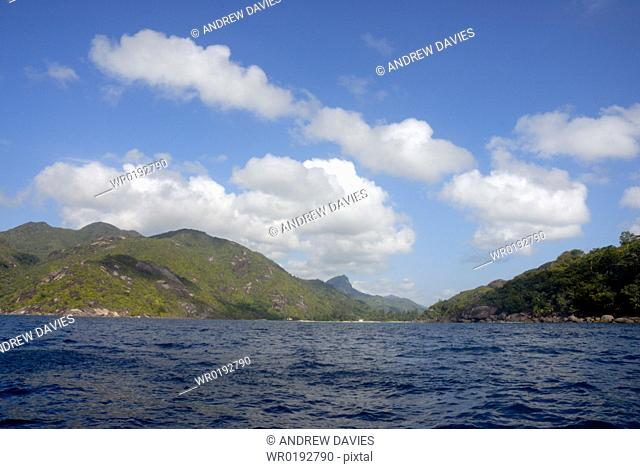Granite and plam trees, coastal scenery, Baie Ternay Marine Park, Mahe, Seychelles, Indian Ocean
