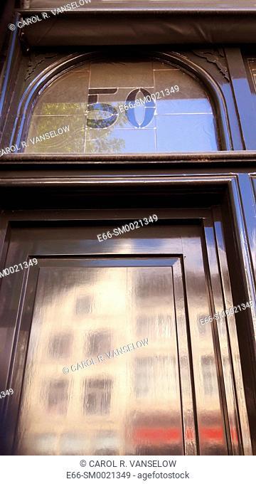 shop door in the city center in Maastricht with the number 50 over the door