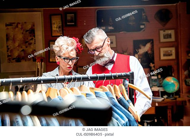 Quirky vintage couple shopping in vintage and antique emporium
