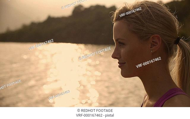 Close up of relaxed woman drinking water, Marbella region, Spain