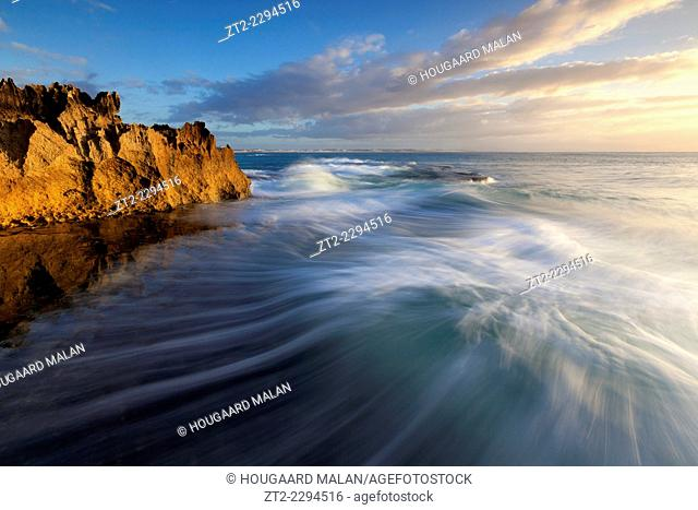 Landscape photo of a dramatic seascape sunrise. Arniston/Waenhuiskrans, Western Cape, South Africa