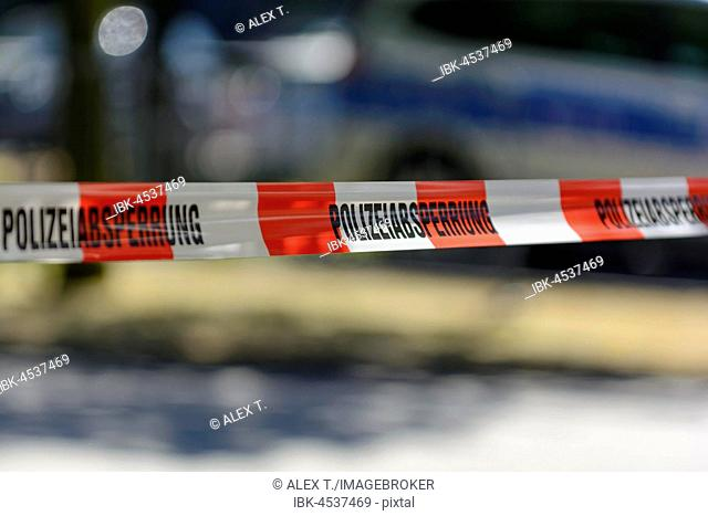 Police cordon with barrier tape, at back a patrol car, Frankfurt am Main, Germany