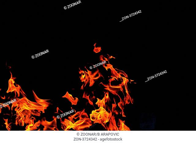 wild fire flames burn hot with black background
