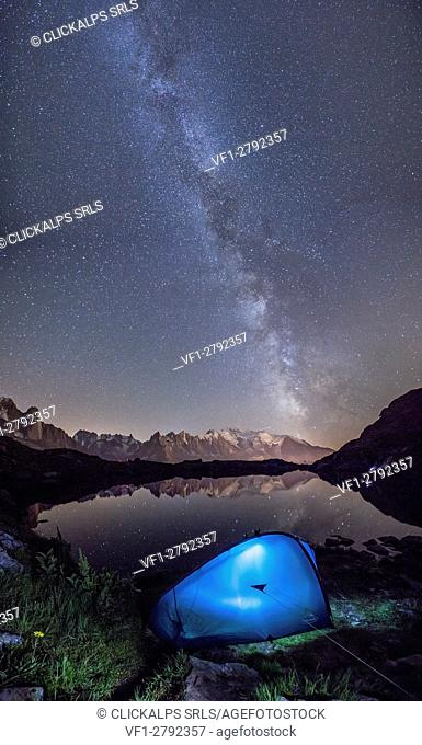 Camping under the stars at Lac de Cheserys. In the background the range of Mont Blanc. Haute Savoie. France