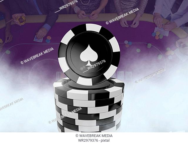 3D Poker chips in front of people gambling in casino on table