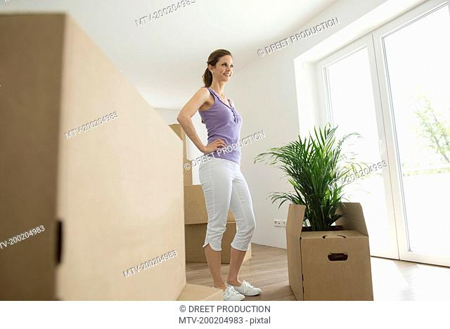 Cardboard packing cases woman decision new home
